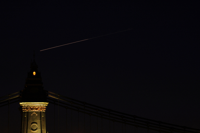 hammersmith bridge with plane trails