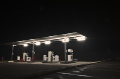 Nondescript gas station at night